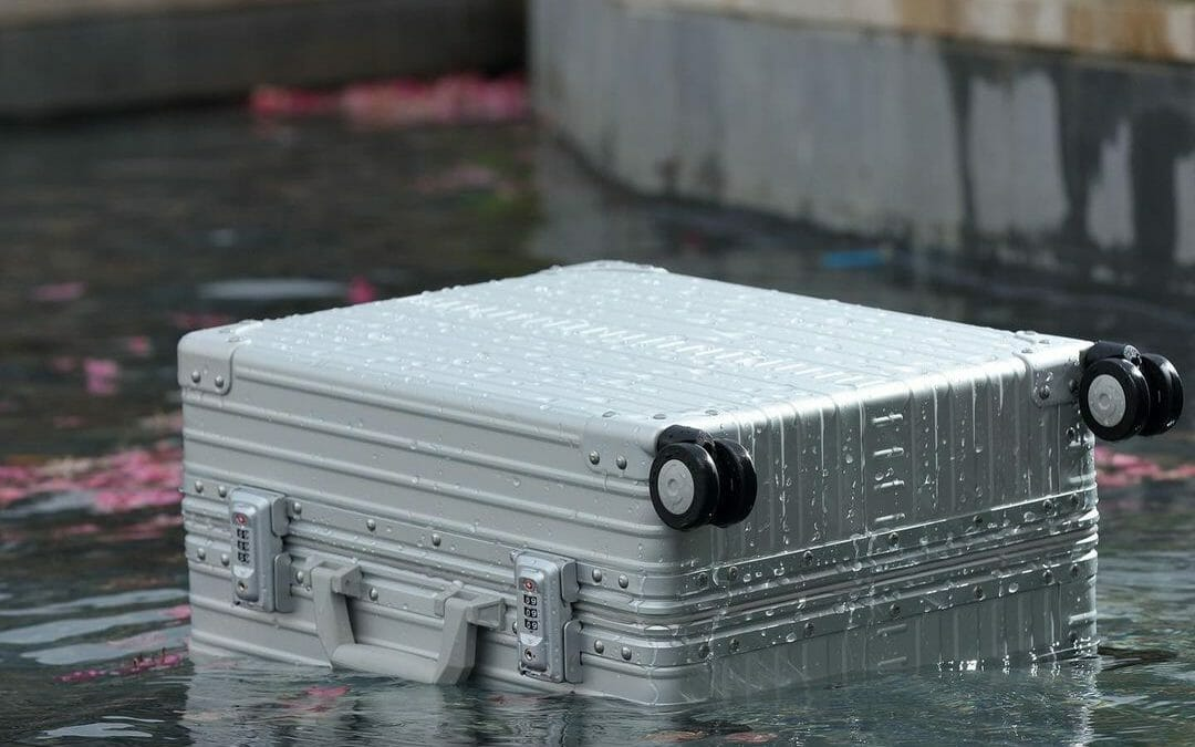 aluminum carry-on luggage in water
